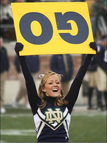 Cheerleader with sign upside down. Pom-Pom Mom. marchmatron.com