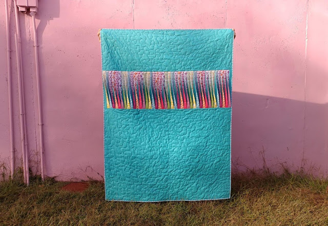 Texture quilt with 3-D twisted strips