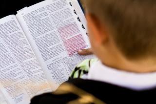 A boy reading the Book of Mormon