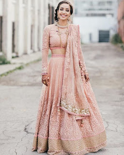 Light pink color Indian saree. It looks so beautiful.