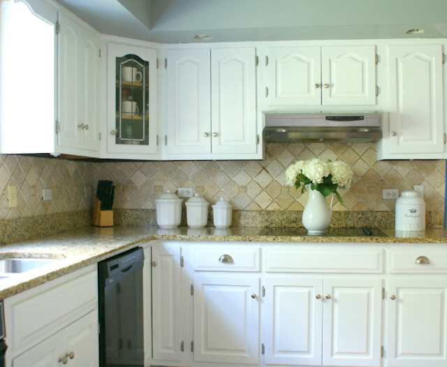 kitchen white cabinets stone countertops electric stovetop