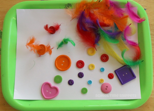 simple preschool threading with buttons and feathers