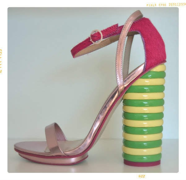 single shoe with Twister ice lolly striped heel on white background