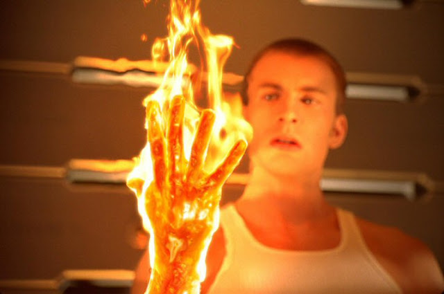 Johnny Storm's hand on fire as The Human Torch in Fantastic Four movieloversreviews.filminspector.com