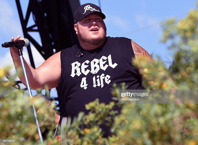 """Clay """"Uncle Snap"""" Sharpe of The Lacs wearing a 'REBEL 4 life' shirt"""