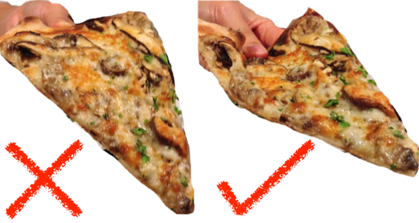 21 Daily Things You've Been Doing Incorrectly All Your Life & How To Do Them Right - A pizza should always be held by folding it a little to make a U-shape so as to prevent it from flopping over.