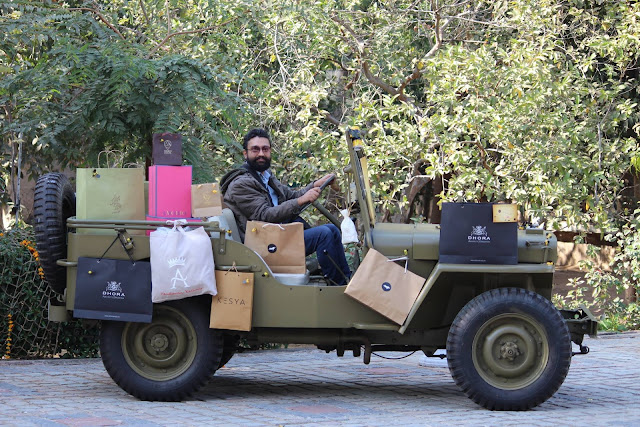 Deep Jagdeep Singh, riding a life size artifact installed at an art exhibition in Jaipur