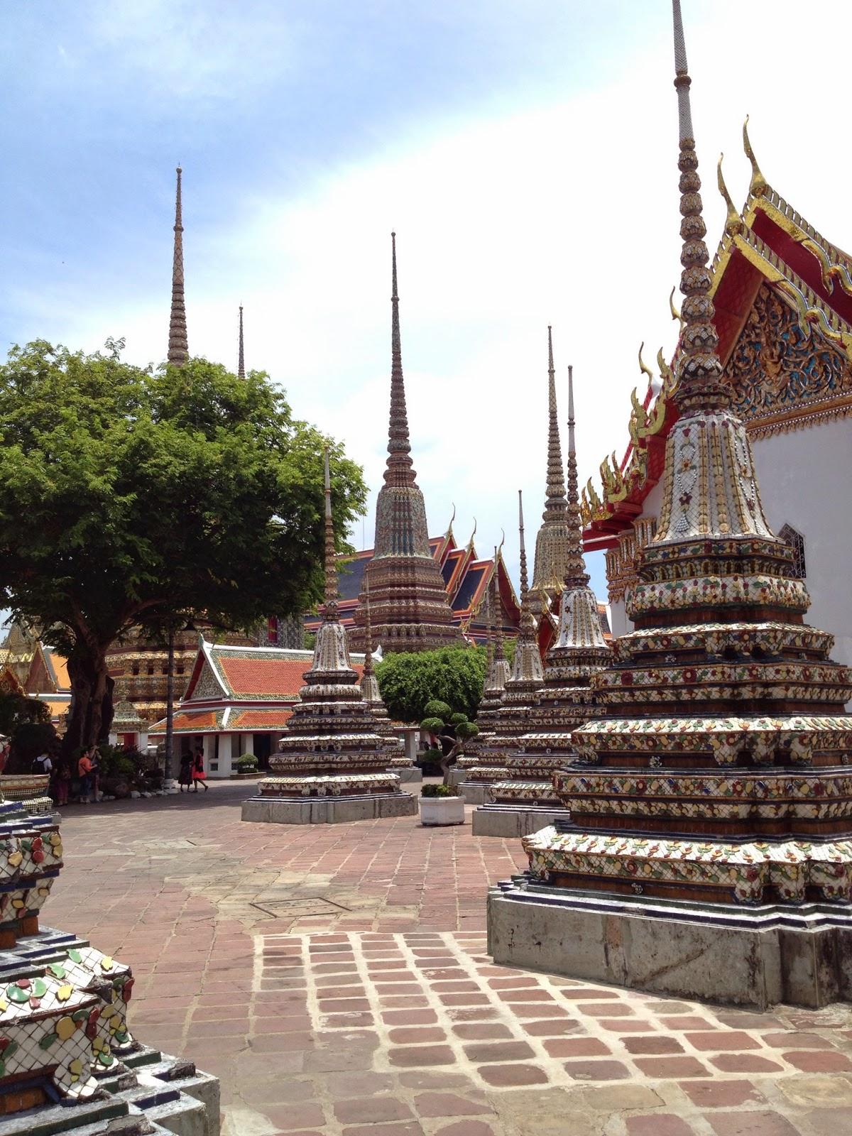 Bangkok - Wat Pho - Smaller chedis contain the ashes of the royal family