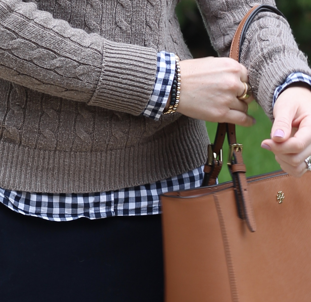 gingham button up, tan camel cable knit sweater, navy pencil skirt, cognac riding boots, Tory Burch tote