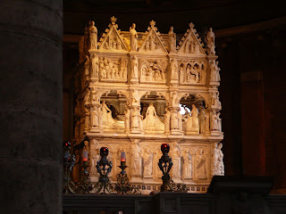 The elaborately carved tomb of St Augustine in the Basilica of San Pietro in Ciel d'Oro in Pavia