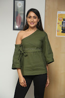 Pragya Jaiswal in a single Sleeves Off Shoulder Green Top Black Leggings promoting JJN Movie at Radio City 10.08.2017 049.JPG