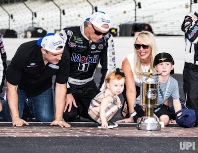 Kevin Harvick with his family and his boss Tony celebrating a better race