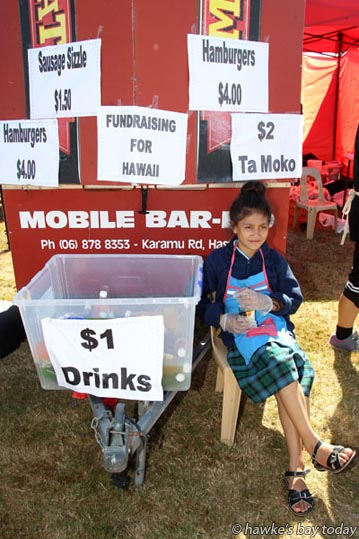 Katarina Hokianga, 10, fundraising for Te Kura Kaupapa Maori O Te Wananga Whare Tapere o Takitimu, Hastings, at Waitangi Day Big 9, a Waitangi Day event hosted by Ngati Kahungunu Iwi Incorporated, at Hawke's Bay Regional Sports Park, renamed Kahungunu Park for February.  photograph