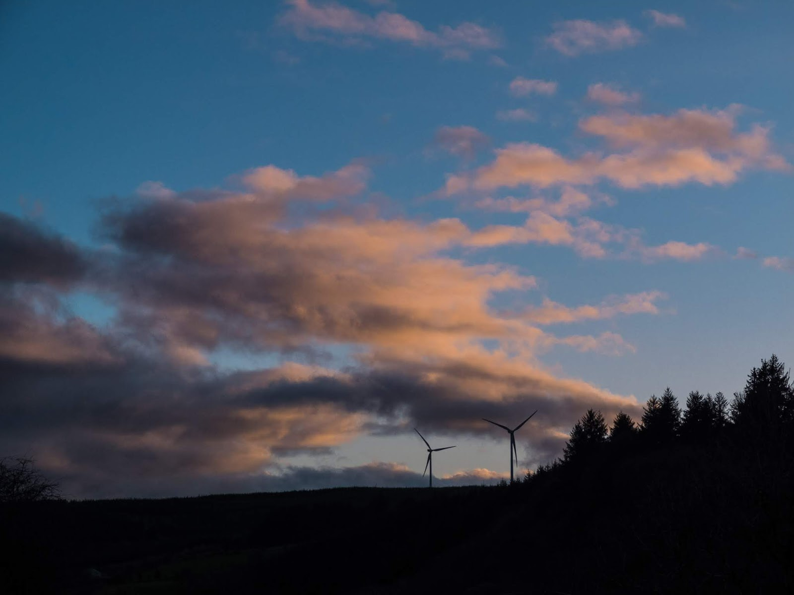 Windmill and forest landscape at sunset in the mountains of North Cork, Ireland.