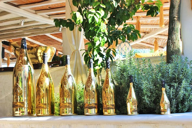 Nammos Mykonos gold champagne bottles