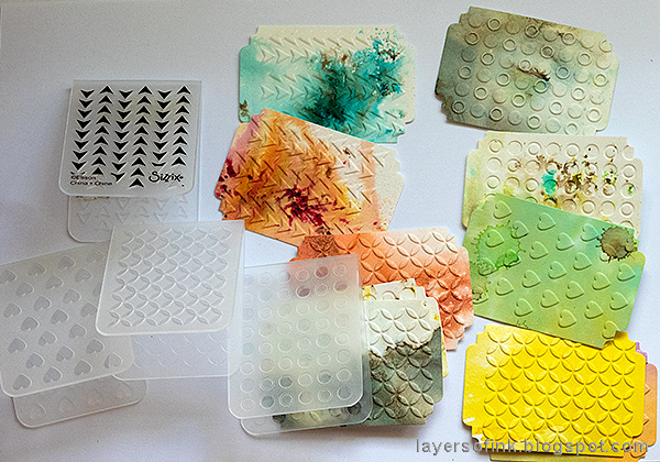 Layers of ink - Ticket Mini Book Tutorial by Anna-Karin Evaldsson, with dry embossing