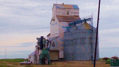 Giant silos and grain shed stands on the Canadian prairie