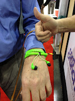 Cord Cruncher earphones wrapped around Mike's wrist