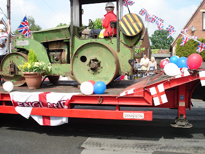 Vintage Steam Roller on float in village parade Gawthorpe