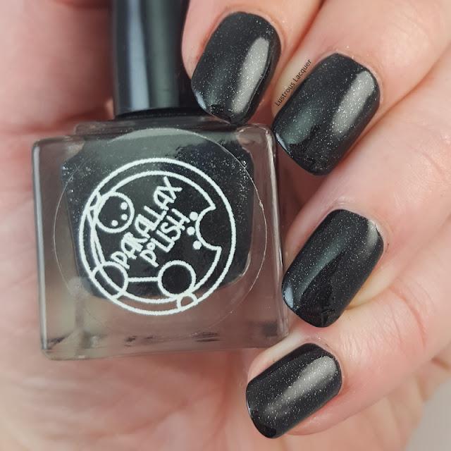 Matte-black-nail-polish-with-silver-foil-flecks