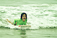 Female camper boogie boarding at Aloha Beach Camp. Aloha Beach Camp is a co-ed summer camp in Los Angeles, California with daily transportation service to and from camp for enrolled kids.