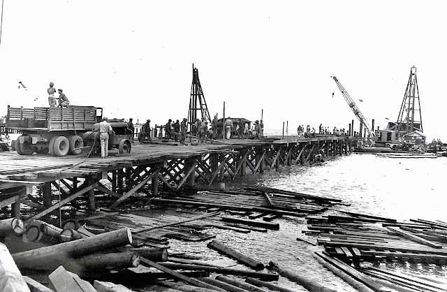 "1052nd Engineer Dock No. 3, showing details and three stages of construction.  Base ""R,"" Batangas, Luzon, P.I.  Taken 29 June 1945."