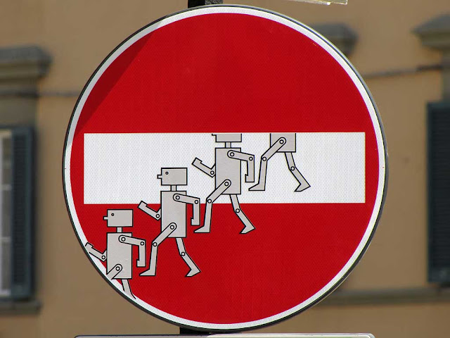 Clet Abrahams, alien invasion from a no-entry sign, via Borra, Livorno