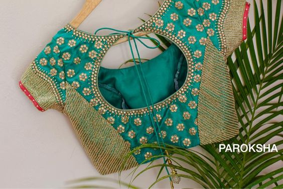 5185aa5bb6 10 Best Silk Saree Blouse Designs For Diwali. Green color blouse with polka stone  work