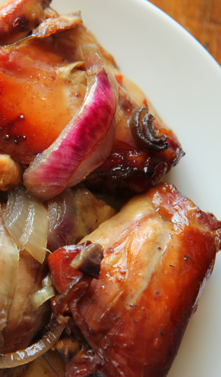 This slow-cooker chicken thigh recipe features beautiful red onion and strawberry jam!