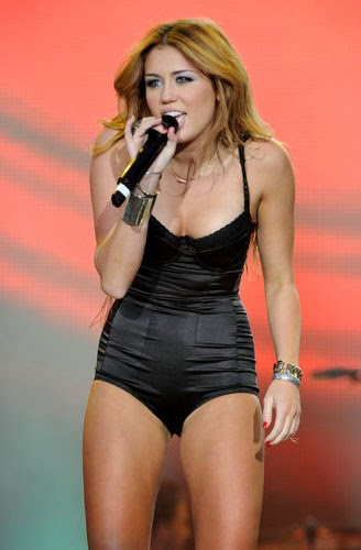 Miley cyrus in a body on the stage
