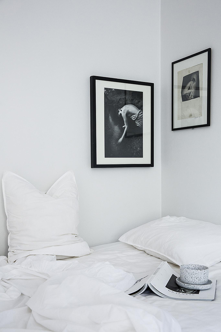 Black and white art on the bedroom wall | Fantastic Frank