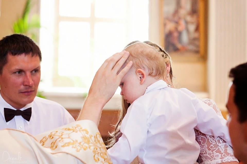 Krikštynų ceremonija.