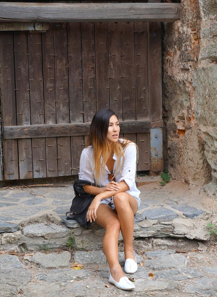 Euriental | white cotton shirt with pastel green shorts at Rumeli Castle in Istanbul
