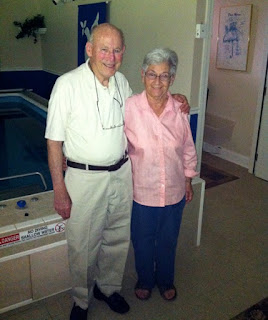 Ernie and Marge H. in front of their home's Endless Pools swimming machine.