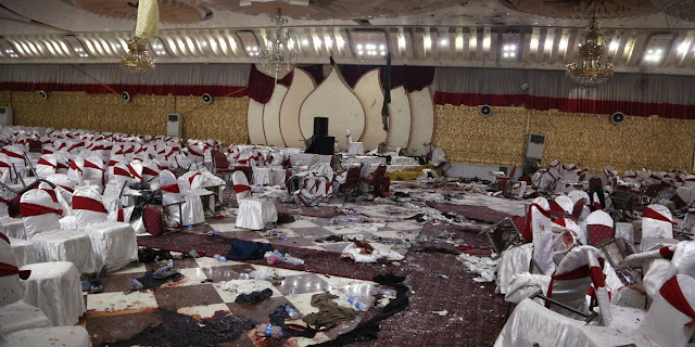 Suicide Bomber kills 55 in Kabul Attack | Image Attribute: Inside of a wedding hall in Kabul, Afghanistan, is seen Wednesday, Nov. 21, 2018, a day after a suicide attack. A suicide bomber was able to sneak into the wedding hall where hundreds of Muslim religious scholars and clerics had gathered to mark the birthday of the Prophet Muhammad. Source: AP Photo/Rahmat Gul