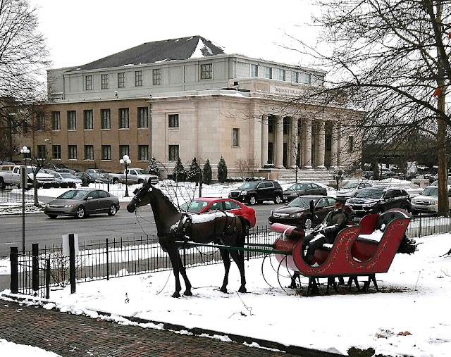 Sleigh in front lawn of Harrison Home.