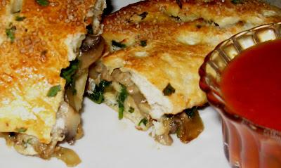 Turkey Sausage Mushroom Onion And Spinach Calzones