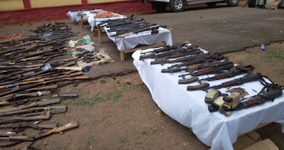 nigerian man surrenders pump action rifle