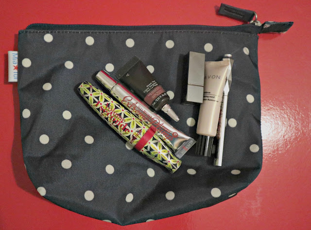 Make up products on a polka dot Mia Tui bag