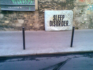 Sleep Disorder on an abandoned mattress