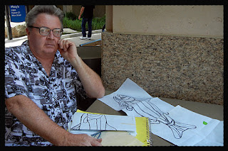 Ken Lund making sketches of trout quilt design at city creek mall salt lake city utah
