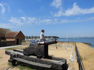 boy sitting on cannon