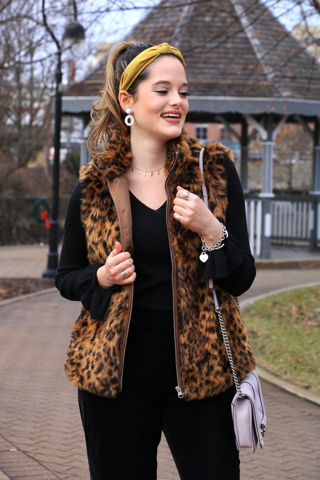 Nyc fashion blogger Kathleen Harper wearing a leopard vest from Jcrew