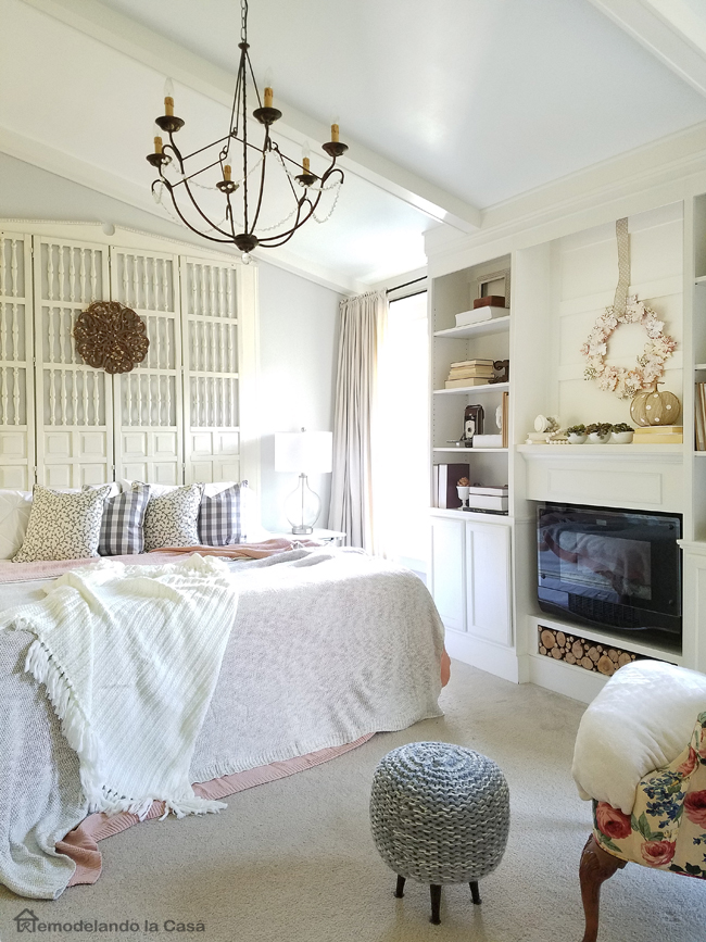 white Master bedroom makeover with built-ins and faux ceiling beams