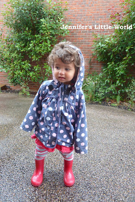 Small child in wellies in the rain