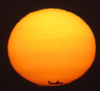 Mercury Transit sunset with airplane