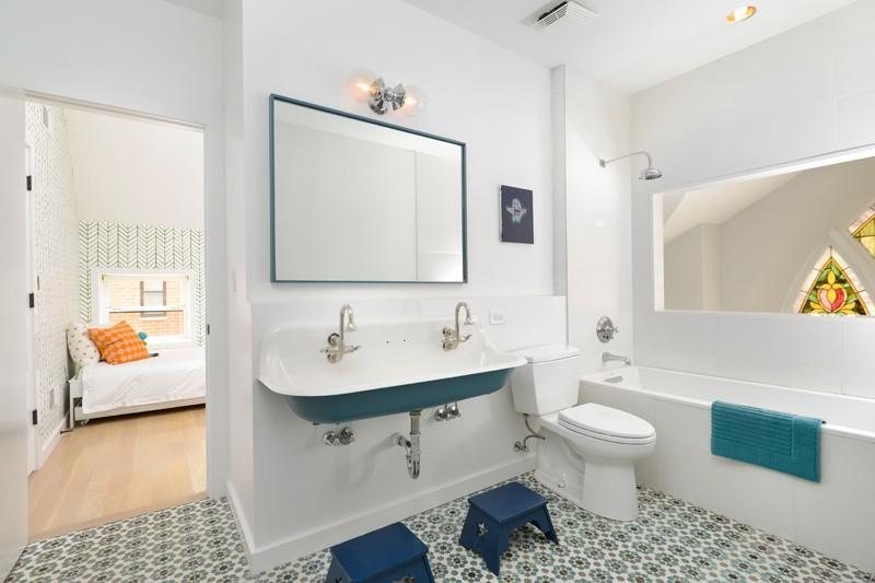 Modern farmhouse bathroom in Church conversion to chic private home Chicago
