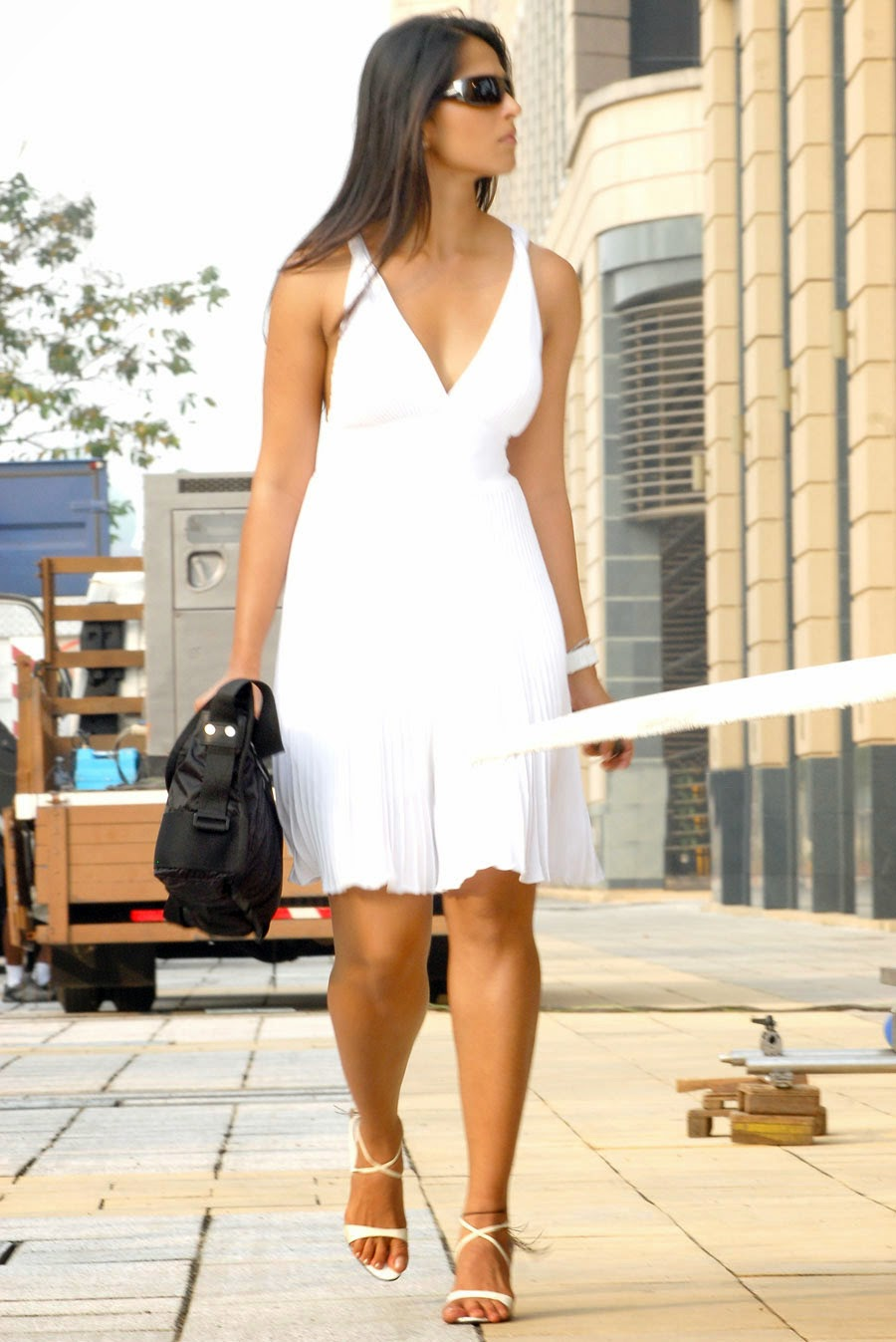 Anushka Shetty Leg Show Photos In White Long Gown