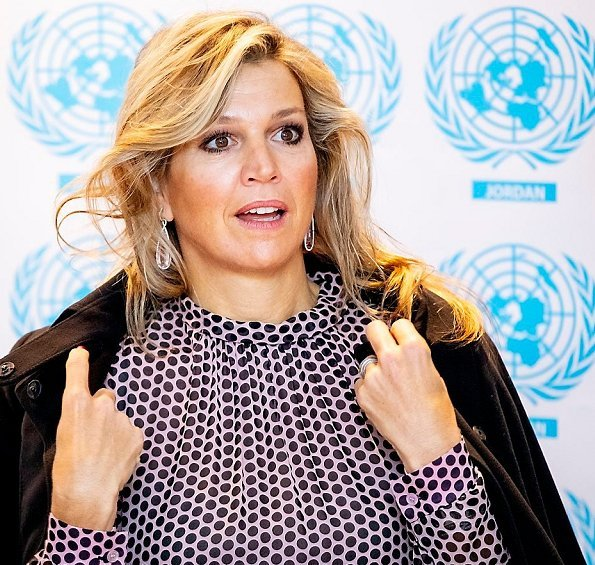 Queen Maxima wore a black wool coat by Natan, and new polka dot dress