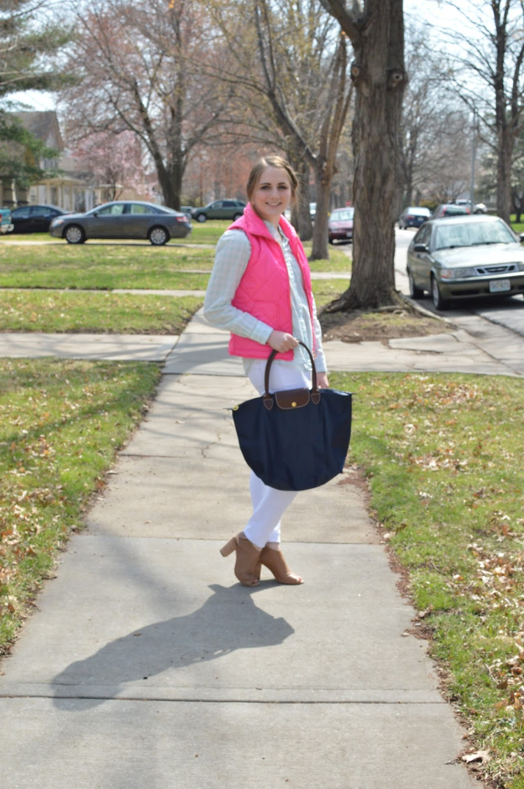 pink puffer vest with a mint green gingham blouse